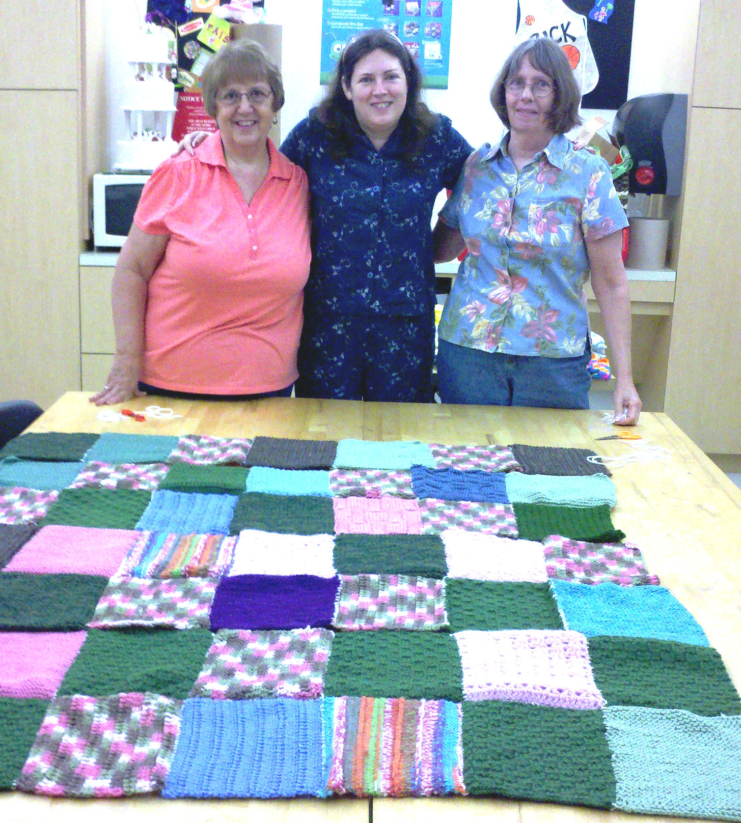 A few of the volunteers who assembled the donated squares to Warm Up America